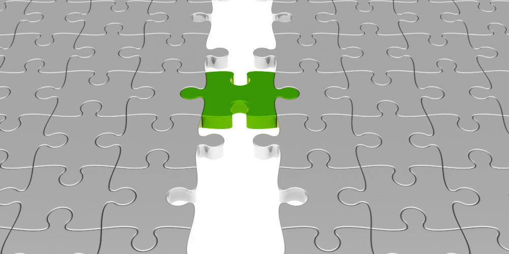 Two silver puzzles joined by one green puzzle piece.