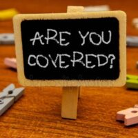 """Upside down clothes pin with sign attached, """"are you covered?"""""""