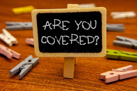"Upside down clothes pin with sign attached, ""are you covered?"""