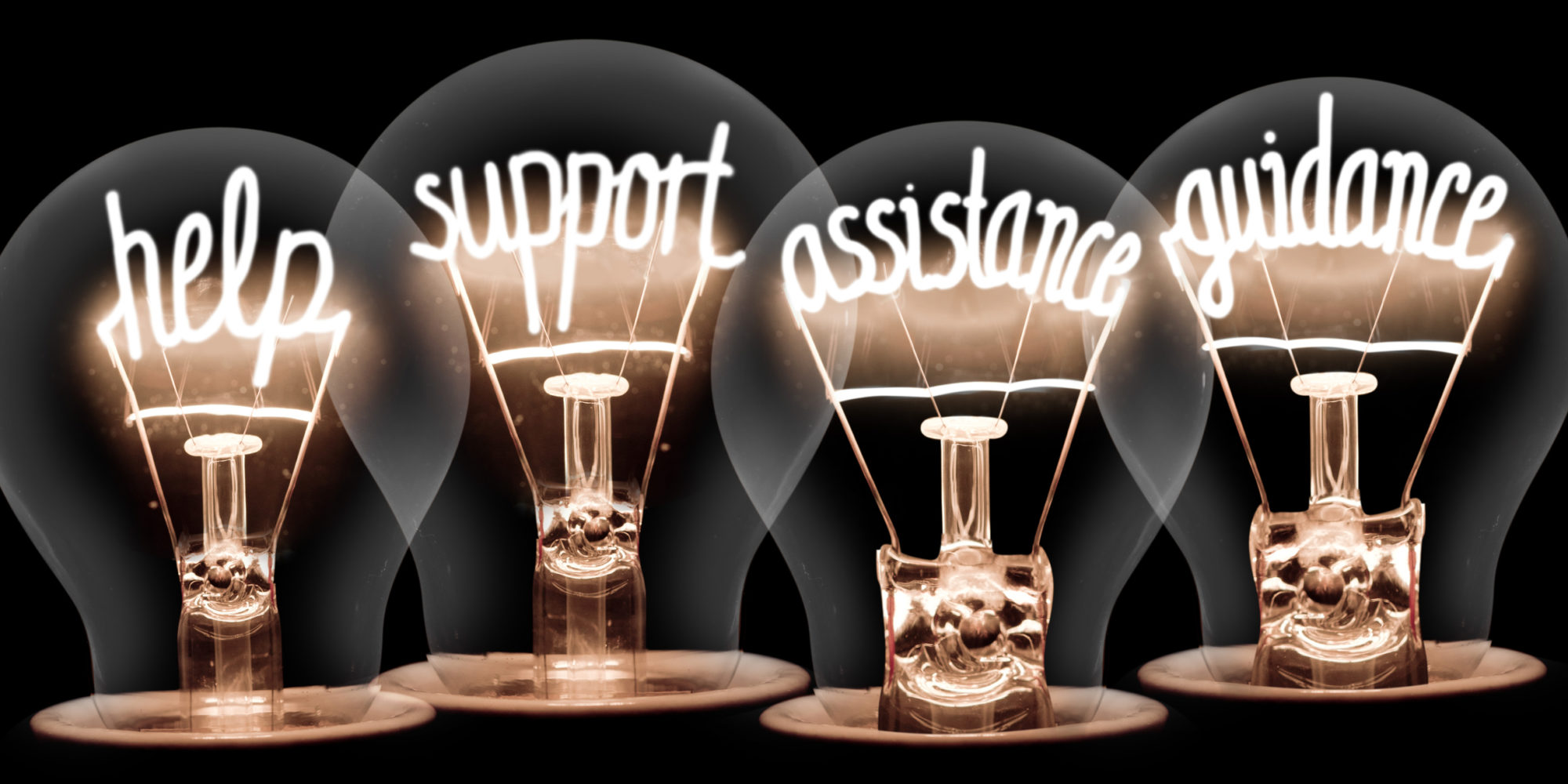 Photo of light bulbs group with shining fibers in a shape of HELP, SUPPORT, ASSISTANCE, GUIDANCE concept words isolated on black background.